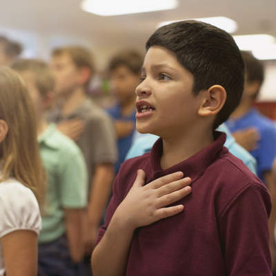 Children reciting Pledge of Allegiance in school