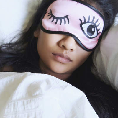 آپنه خواب High Angle View Of Woman Wearing Eye Mask While Sleeping In Bed
