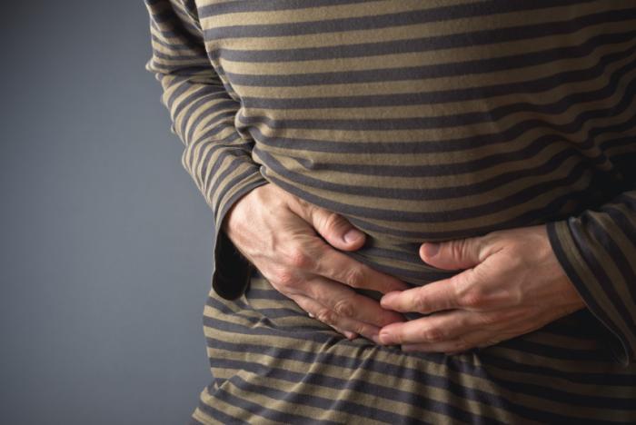 اسهال man-with-stomach-cramps
